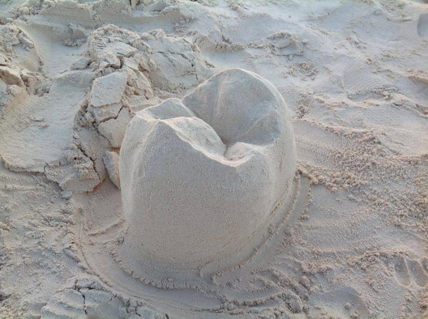 Зуб из песка 5
