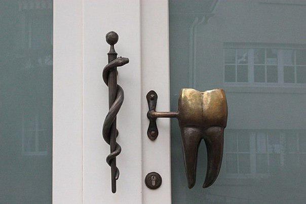 Дверная ручка - зуб