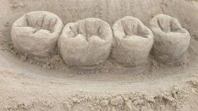 Зуб из песка 6