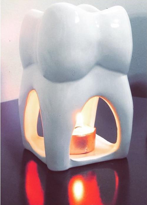 Зуб - подсвечник