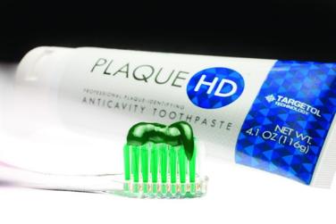 Новая зубная паста окрашивает зубной налет в зеленый цвет