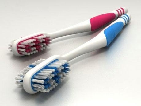 Двухсторонняя зубная щетка