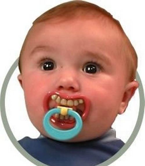 детская соска с зубами